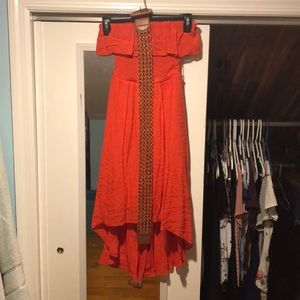 A red-orange dress, off the shoulder with belt